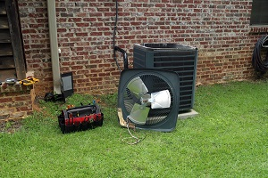 Air Conitioner Condenser coil with tools being repaired