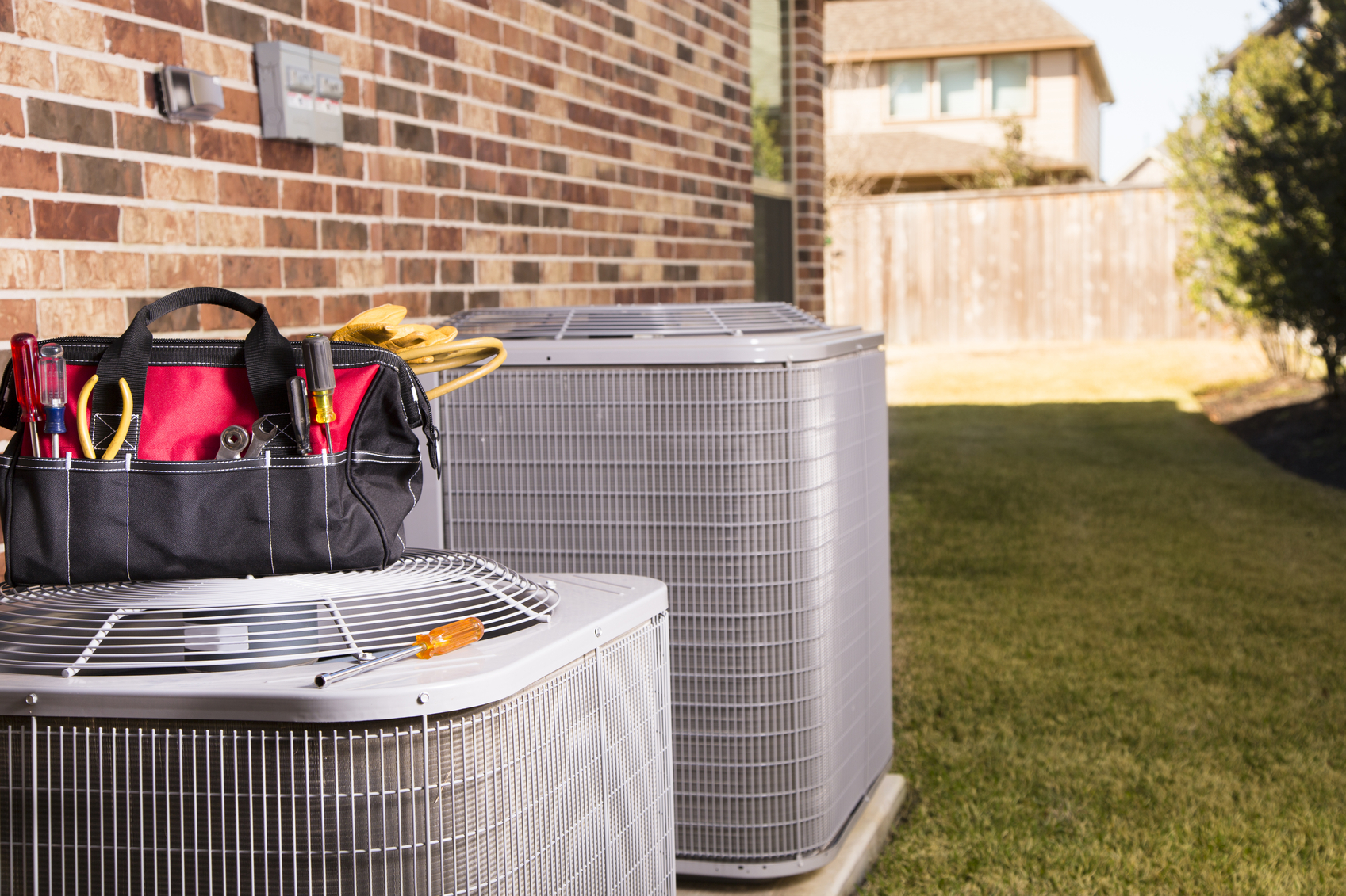 Service Industry: Work tools, air conditioners. Outside residential home. Summer
