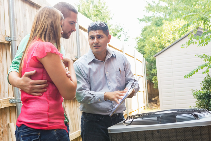 Air Conditioner repairman with couple