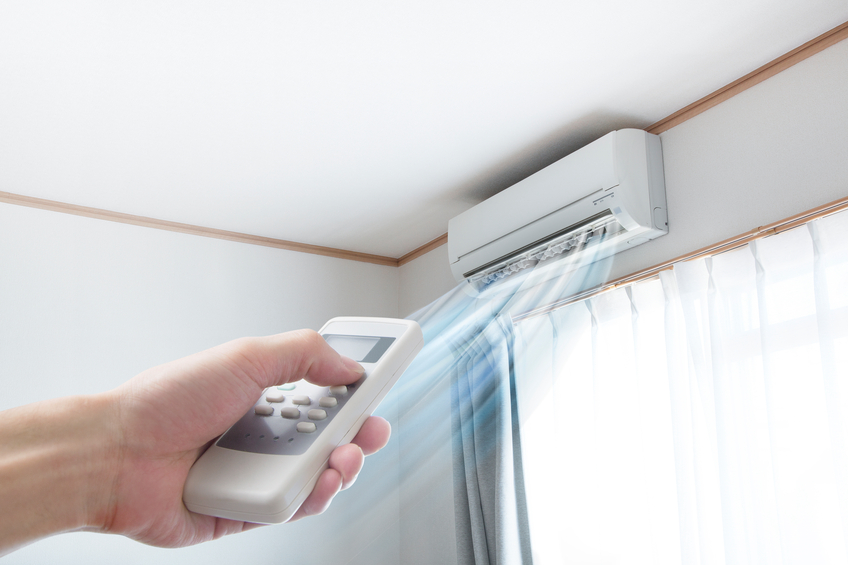 Air conditioner blowing cold air through vent