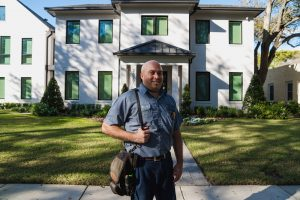 Cox technician in front of house